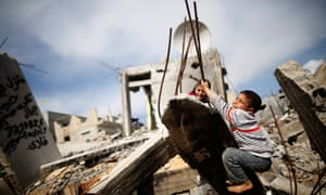 Palestinian children play in the rubble of a destroyed house in Gaza Strip. Should businesses be more concerned about the future of the world's children?