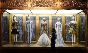 A cut above: some of Alexander McQueen's designs on show at the V&A, including a golden feather dress, centre, 'that would make any woman fly'.