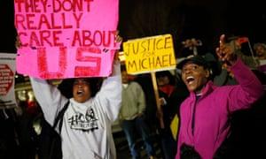 Protesters demonstrate across the street from the Ferguson Police Department in Ferguson, Missouri, on Thursday.