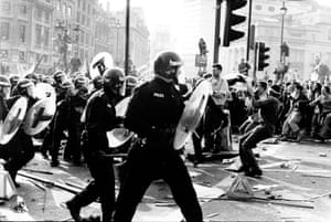 Riot police move in on protesters in central London on 31 March 1990.