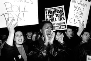 Anti-poll tax protesters jeer councillors from the east London borough of Newham as they leave a meeting on 7 March 1990.
