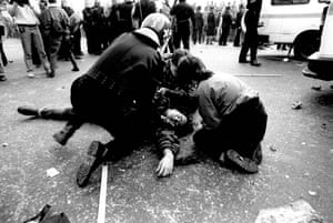 A member of the public lies injured in Trafalgar Square, London. More than 100 people, including police officers, were hurt.