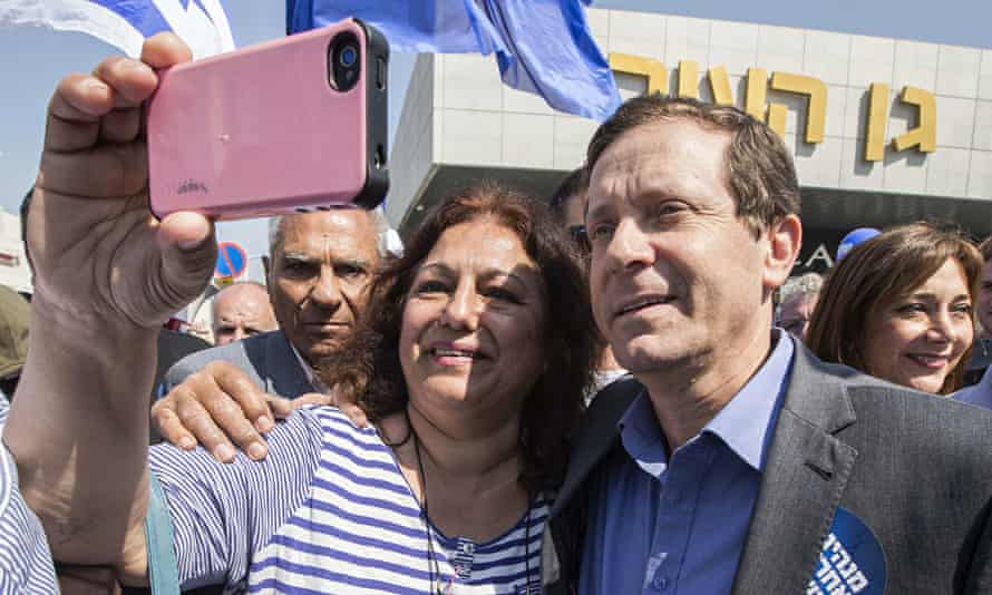A supporter takes a selfie with Israeli