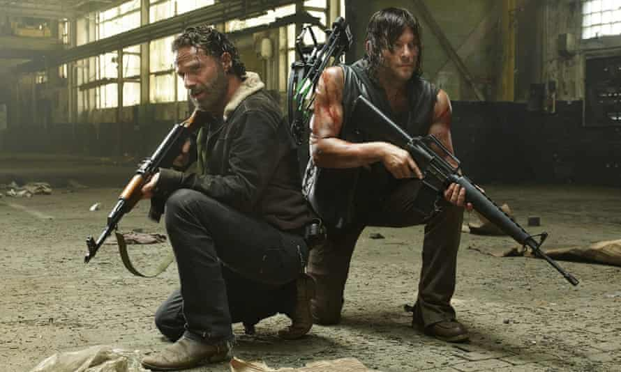 Andrew Lincoln as Rick Grimes and Norman Reedus as Daryl Dixon in The Walking Dead.