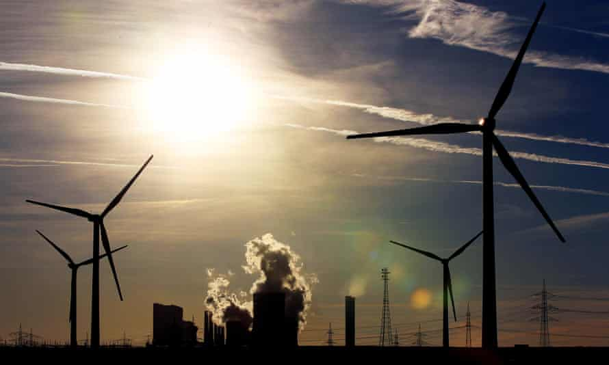 Wind turbines in front of the RWE brown coal-fired power plant near Bergheim, Germany.  A new study concludes that wind energy is far cheaper than coal, when accounting for all costs.