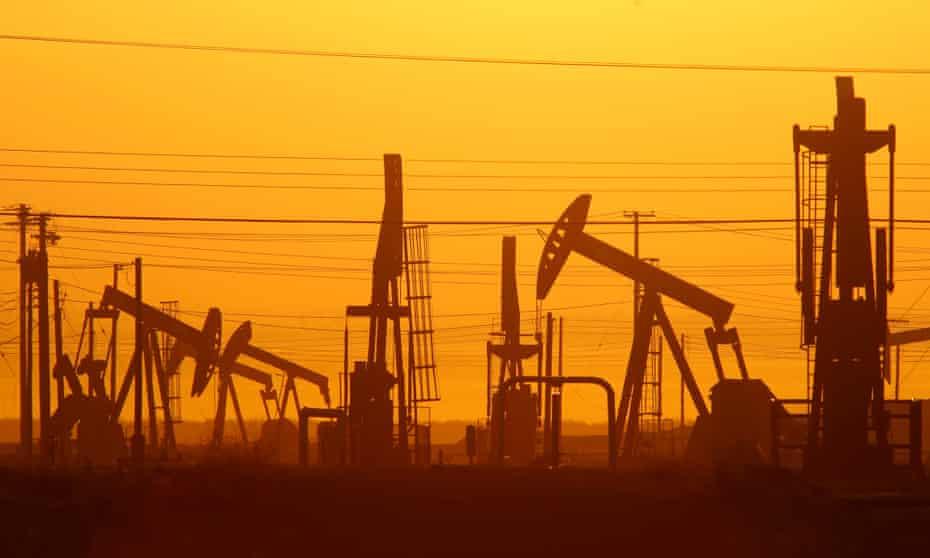 Pump jacks are seen at dawn in an oil field near Lost Hills, California.