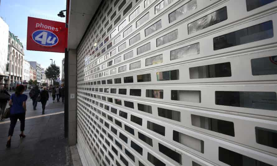 Phones 4U shop in central London with its shutters down