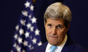 John Kerry listens to a journalist's question during a news conference Saturday.