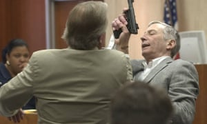 Robert Durst, right, and his attorney Dick DeGuerin demonstrate how Durst struggled with Morris Black during testimony in 2003, in Galveston, Texas.