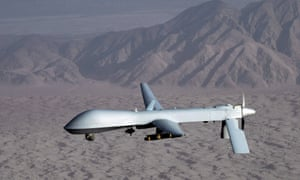 An undated handout picture by the US Air Force shows a MQ-1 Predator unmanned aircraft in flight at an undisclosed location.