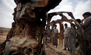 Boys gather near the wreckage of car destroyed last year by a US drone air strike targeting suspected al Qaeda militants in the southeastern Yemeni province of Shabwa in 2013.