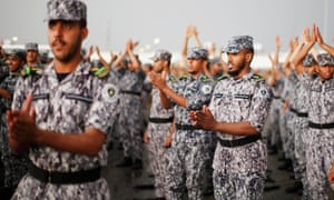Members of the Saudi security forces take part in a military parade.