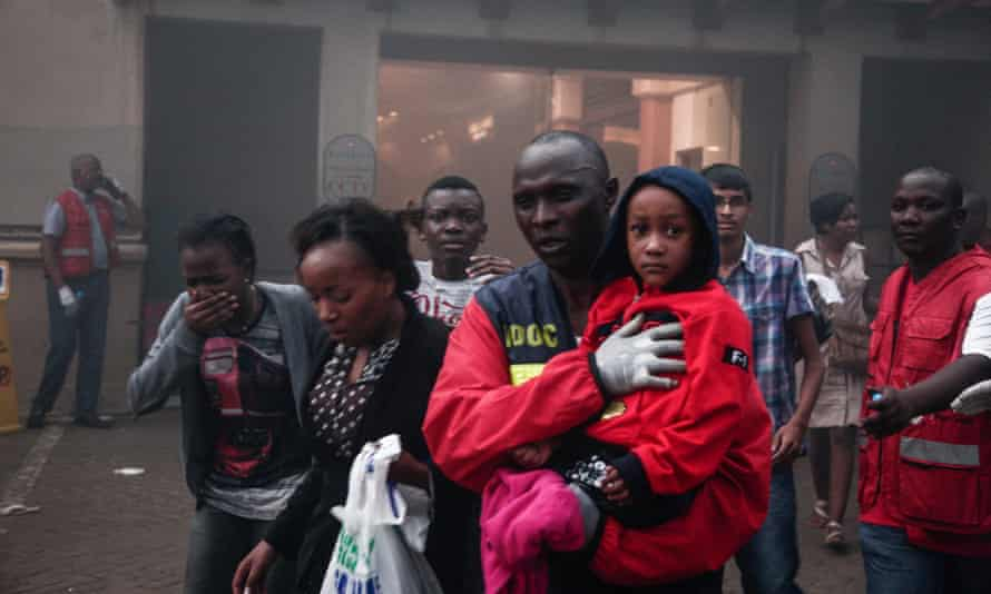 People escape from Westgate shopping mall after an attack claimed by al-Shabaab in September 2013.