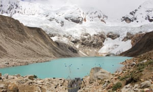 pix from GermanWatch of the Palcacocha lagoon which is above the city of Huaraz and threatens the claimant's home, Peru. That is the lake that may outburst in the case of ice avalanches. On some of those photos you can also see the drainage system in place, which however is not sufficient to secure the lagoon.