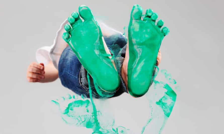 Feet covered in green paint