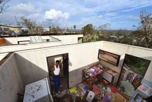 Uwen Garae surveys his damaged house in Port Vila
