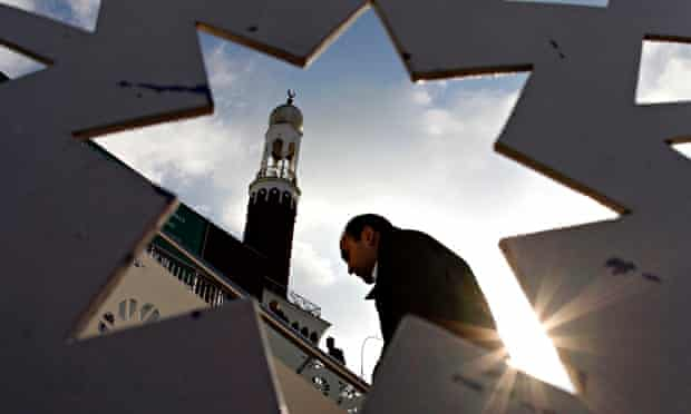 A man arrives for Friday prayers at the central Mosque in Birmingham