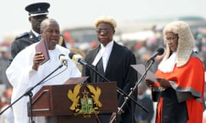 Ghana's President John Dramani Mahama (L) takes an oath of office, next to Ghana's Chief Justice Georgina Wood (R), at the Independence Square, in  Accra, on January 7, 2013. Mahama was sworn in as president today at a ceremony attended by thousands in the capital but boycotted by the opposition, which has challenged the election results. Mahama, who initially became head of state following the death of his predecessor John Atta Mills in July, pledged to build on the west African nation's economic success in a speech after taking the oath.