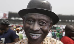 A supporter of Nigeria President Goodluck Jonathan, wears a mask with his image, during an election campaign rally in Lagos.