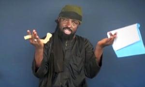 Boko Haram leader Abubakar Shekau making a statement at an undisclosed location.