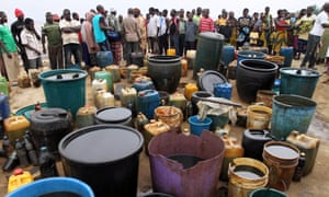 Crude oil collected in containers at the shore of the Atlantic ocean near Orobiri village.