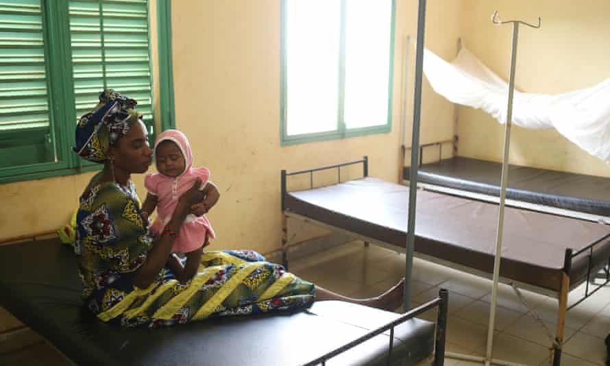 Aiche Kaita, 29, who was diagnosed with malaria, holds her three-month-old daughter Djenna, at the community health centre in Kalabancoro. (WaterAid/Tara Todras-Whitehill)