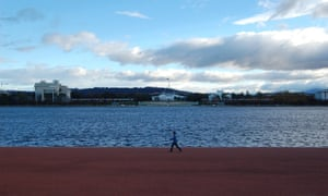 Old and new houses of parliament across Lake Burley Griffin, Canberra.