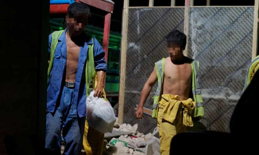 North Korean workers on a construction site in Qatar. The UN says it fears some workers from the country are working in slave-like conditions abroad including in the middle east.
