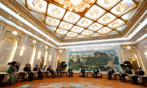 China's President Xi Jinping meets with guests at the Asian Infrastructure Investment Bank (AIIB) launch ceremony at the Great Hall of the People in Beijing in October 2014.