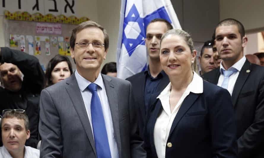 Israeli Labour party Yitzhak Herzog casts his ballot with his wife Michal