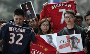 Chinese fans of David Beckham. The government in Beijing has announced plans to boost the country's standing in international football.
