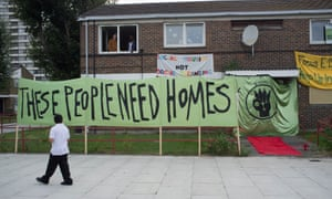 Banners outside occupied flats as members of the group, E15 Mothers staged at a sit-in in September 2014 of the almost empty Carpenters estate in Newham to highlight the lack of affordable housing in London.
