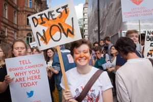 Demonstrator holds a placard at a recent protest in central London.