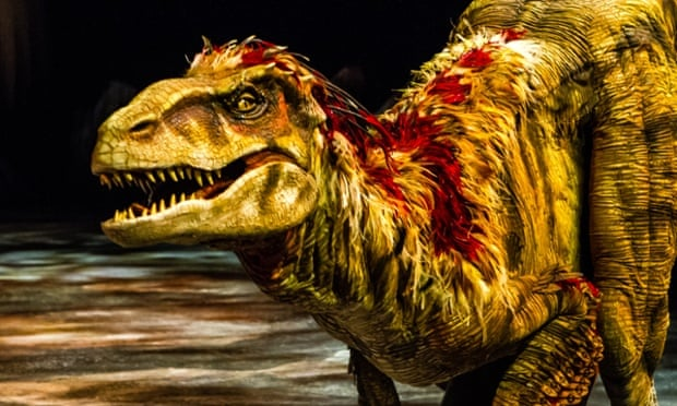 This image released by Boneau/Bryan-Brown shows a lifelike dinosaur, part of the