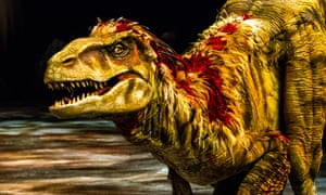 """This image released by Boneau/Bryan-Brown shows a lifelike dinosaur, part of the """"Walking with Dinosaurs, the Arena Spectacular,"""" in New York. The show, based on an award-winning BBC Television series, travels 200 million years from Triassic to the Jurassic and Cretaceous periods, and features 10 species of dinosaur."""