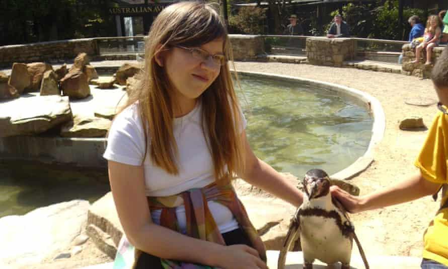 Ella touches a penguin
