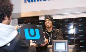 A Nintendo fan purchases one of the first Wii U systems in the world in November 2012.