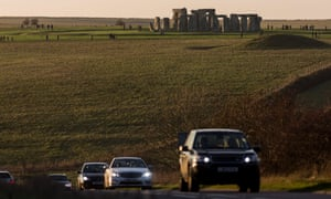 Traffic on the A303 at Stonehenge – plans to build a tunnel to 'reunite' the landscape have divided opinion.