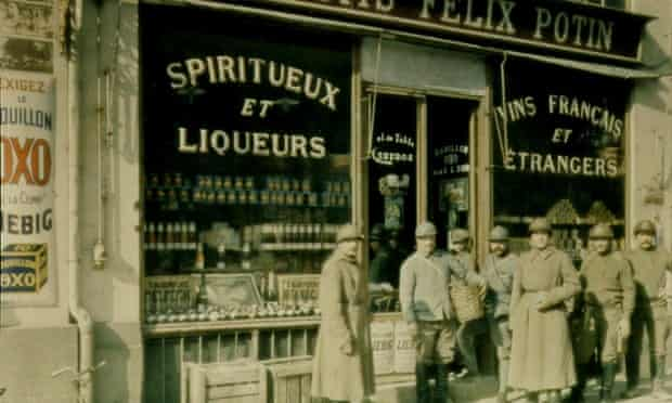 French infantrymen, informally known as Poilus or Hairy Ones, outside wine shop, France, 1916