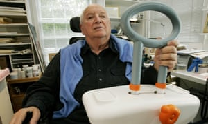 Michael Graves with the bathtub handle he designed to help handicapped and elderly people.