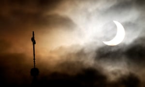 A partial solar eclipse is visible over the city of Warsaw on January 4, 2011