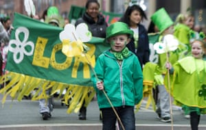 Children take part in the annual St Patrick's Day parade in Belfast, Northern Ireland