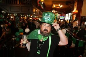 A patron celebrates at P.J. O'Brien's Irish pub  in Sydney, Australia