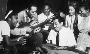 Rosetta Tharpe, left, with Duke Ellington on guitar and Cab Calloway on piano in 1939 during a jam session.