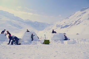 Families building igloos in the sunlight at Adelboden, Switzerland.