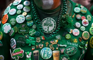 A man wears Irish badges as he watches the 254th New York St Patrick's Day parade, on 5th Avenue