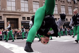 A dancer flips in the air during the St Patrick's Day parade in New York
