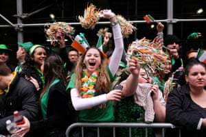 Spectators cheer during the St Patrick's Day parade in New York