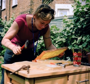 Camilla in her garden, making up some new super frames for her hives.  Worker honey bees secrete wax from glands under their abdomen, and given the thousands of bees in an active colony and enough time, substantial quantities can be produced. The bees use it as a building material, crafting it into the familiar hexagonal honeycomb arrangements that so efficiently make up individual containers for pollen, honey or larvae.  These frames have a sheet of preformed wax that even has slight bumps to help the bees with their geometry.