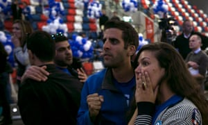 An unclear result: Zionist Union party supporters react after hearing exit poll results in Tel Aviv.